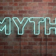 MYTH - fluorescent Neon tube Sign on brickwork
