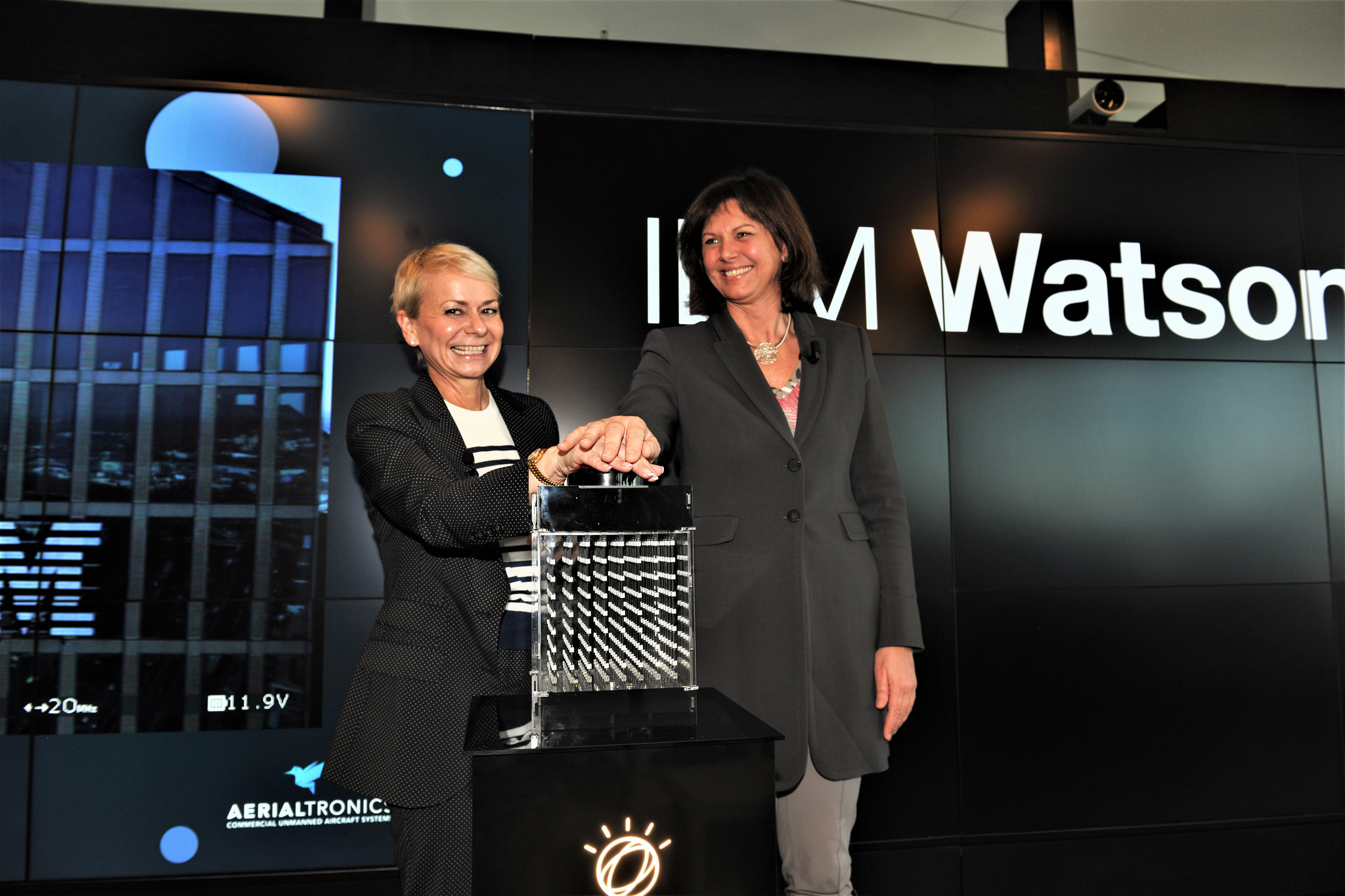Harriet Green, IBM (left) and Ilse Aigner, Bavarian State Minister of Economic Affairs and Media, Energy and Technology press the button to activate IBM's new global centre for Watson IoT in Munich. (Credit: IBM)