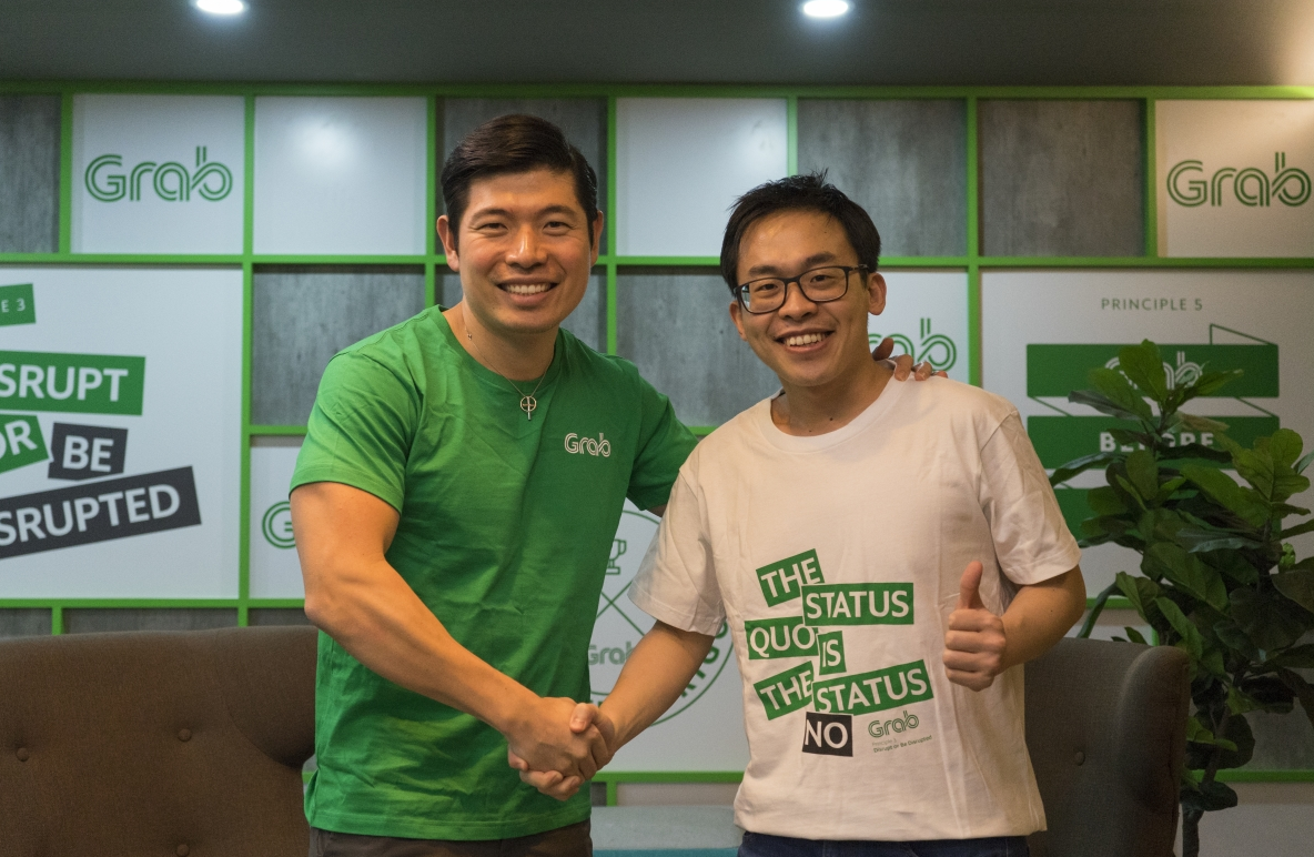 Grab CEO and co-founder Anthony Tan (left) with Albert Lucius, CEO of Kudo
