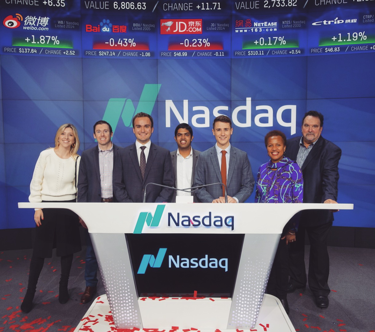 Members of the winning team from the 2017-2018 competition, the New Haven Bulldogs, at the Nasdaq with members of Voleo.